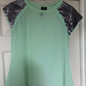Sheer mint green top with sparkled shoulders